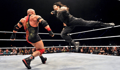 superman-punch-by-roman-reigns-to-rayback
